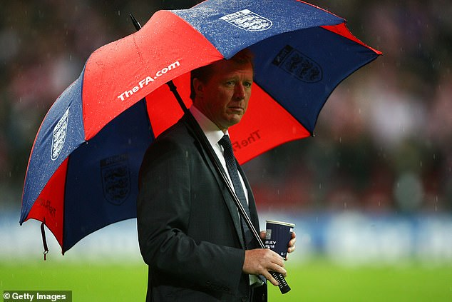 SteveMcClaren stands in the rain as Euro 2008 qualification slipped away at Wembley