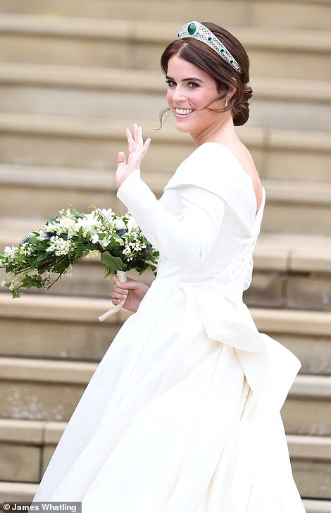 The royal wave! Princess Eugenie paused to greet the crowds as she made her way into St George's Chapel
