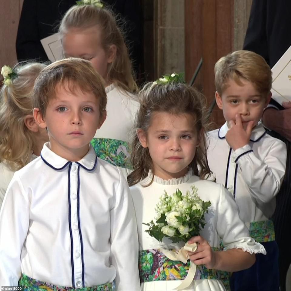 Louis de Givenchy, the son of Eugenie's friendsFrenchman Olivier de Givenchy, a senior banker at JP Morgan, and his Australian wife Zoe and Theodora Williams, the daughter of Robbie Williams and Ayda Fields, preparing to walk down the aisle with Princess Eugenie