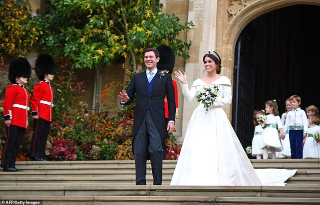 Eugenie and Jack emerge from the West Door of the chapel and wave to the crowds following the lavish ceremony