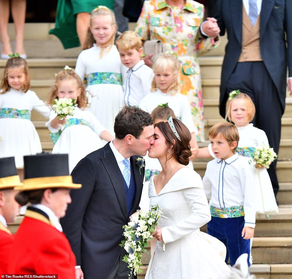Eugenie and Jack shared a kiss on the steps of St George's chapel as their bridesmaids and page boys bounded down the steps behind them