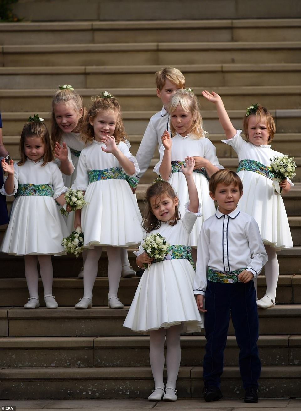 What a send off! Adorable young members of the bridal party gave Eugenie and Jack their best waves as they set off on a 15-minute carriage procession to greet wellwishers