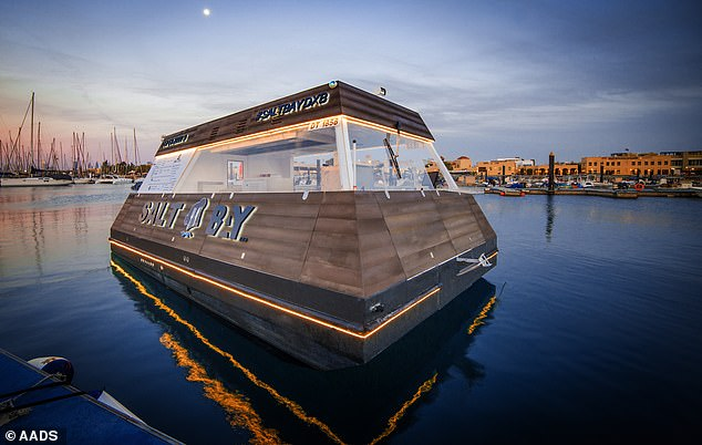 The floating fast-food drive-thru, which has recently been placed in the middle of a lagoon in Dubai