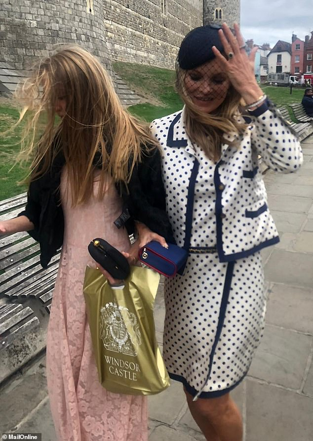 Happy days:Kate Moss was clearly honoured to have scooped her invite as she described the wedding as 'great and beautiful' to MailOnline, while leaving St George's Chapel at Windsor Castle, where she was joined by her daughter Lila, 16