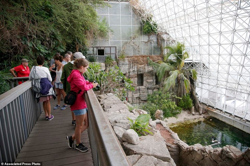 In this July 31, 2015 photo, tourists check out the Biosphere 2 Ocean, holding a million gallons of seawater, designed as an enclosed ecological system to research interactions within ecosystems
