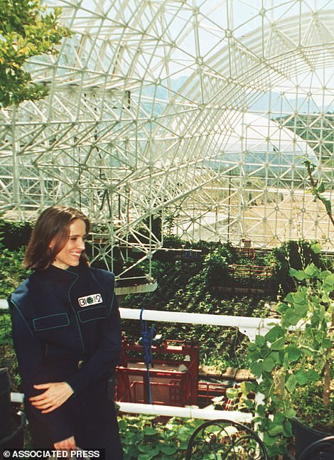 Right: Abigail Alling has a look from the living quarters balcony inside Biosphere 2