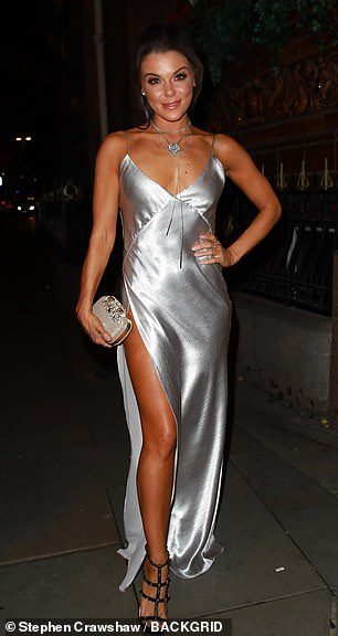 Sparkling: The actress, 31, put on a dazzling display in a metallic silver gown with a daringly high thigh-split as she made her way into the event alongside Lucy Fallon