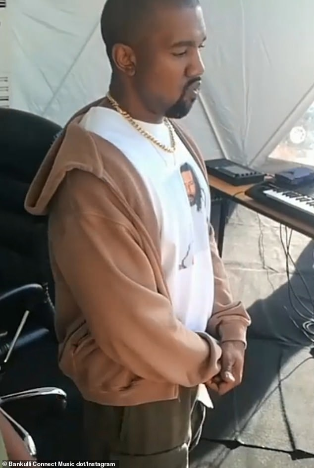 Listening intently: Kanye West got into Immediately, Mystro's hit featuring Wizkid, in a video tweeted by Capital FM Uganda and retweeted by A & R/artist manager Bakulli on Saturday