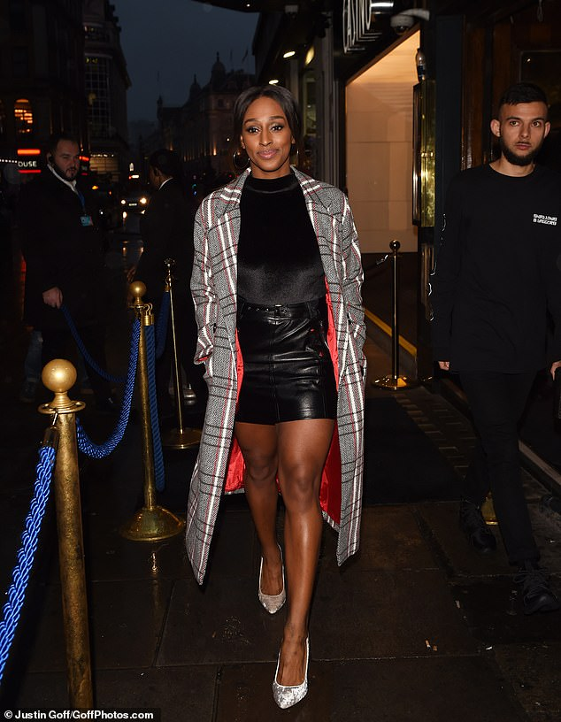 Stylish as ever: She also put on a stylish display ahead of arriving at the charity gala, looking chic in a leather miniskirt