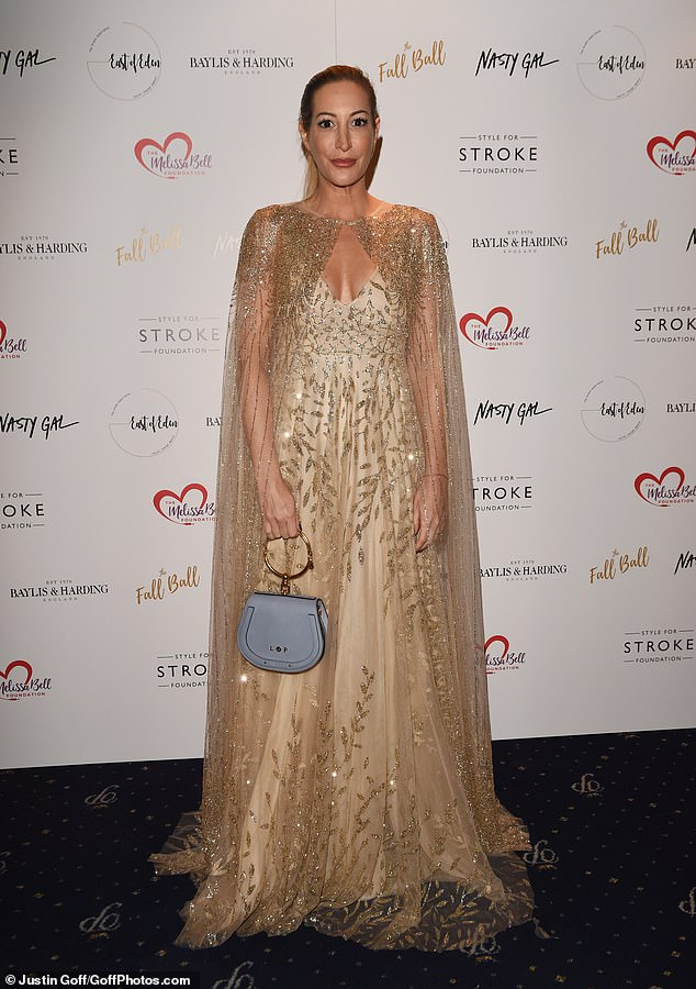 Elegent: Laura Pradelska was hard to miss in an embellished gold gown