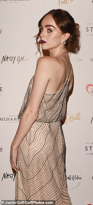 Dressed to impress: Louisa Connolly-Burnham turned heads in a nude halterneck number