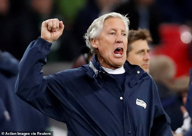 Seahawks head coach Pete Carroll punches the air after one of his side's three touchdowns