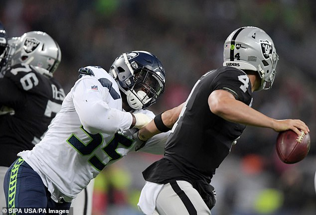 It was a night to forget for Raiders quarterback Derek Carr, who struggled in the conditions