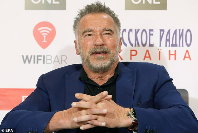 Dye [won't] be back: Arnold Schwarzenegger, 71, looked dapper as he showed off his natural grey hair at business forum in Kiev, Ukraine, on Saturday