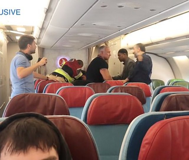 A Man Pulled Out His Camera Phone To Record The Deportation Team At The Back Of