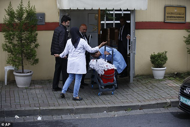 Saudi Arabia has called allegations of murder 'baseless' but has not proved the writer ever left the consulate. Pictured: Cleaners at the consulate on Monday