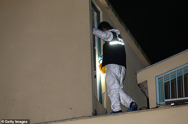 A Turkish crime scene investigation team member inspects the roof of the Consulate General of Saudi Arabia in Istanbul on Monday night