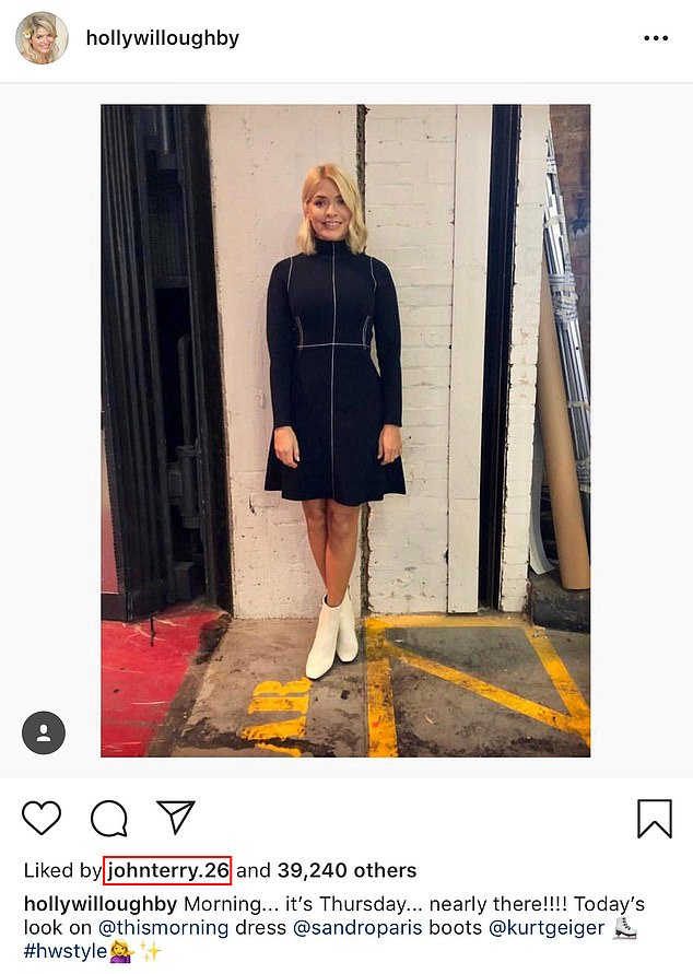 Stylish ensemble: Holly's Sandro Paris high necked dress went down well on Instagram