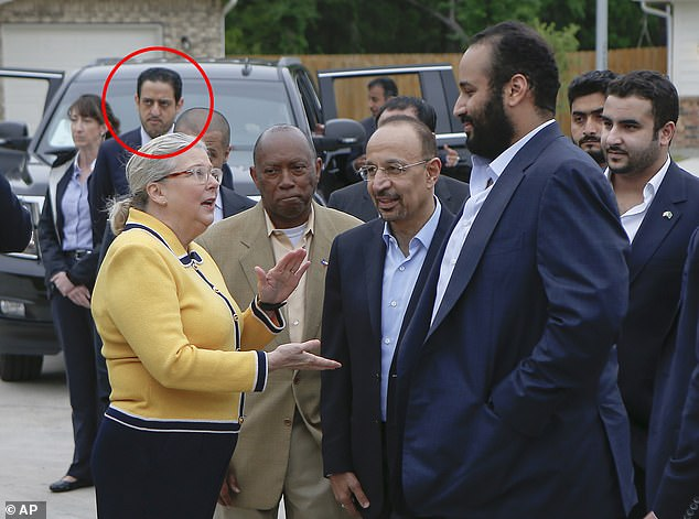 Mutreb,reportedly now being sought by Turkish authorities for questioning over Khashoggi's disappearance, can be seen in the background as Crown Prince Mohammed bin Salman (right) visits a Habitat for Humanity in Houston, Texas in April
