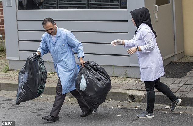 Throwing out the trash: Bags were taken out after the nine-hour overnight visit by Turkish investigators