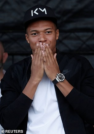 The former Monaco starlet blows kisses as he celebrates France's World Cup victory