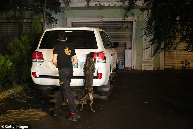 Istanbul Police Department's cadaver dog Melo inspects the garden of the Consul General of Saudi Arabia as part of an investigation on the disappearance of Jamal Khashoggi