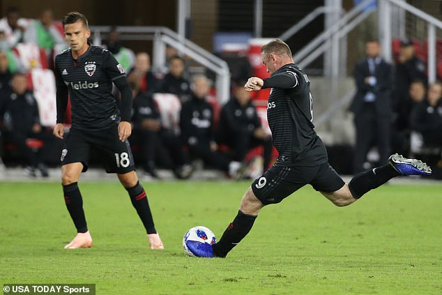 Wayne Rooney strikes a free-kick from long range, bending into the top right-hand corner