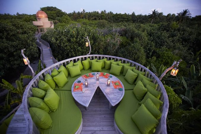 The architecture at Soneva Fushi is nature-inspired and includes walkways that wind through lush woodland