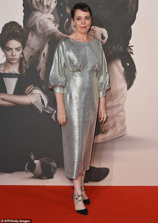 Sensational in silver: Olivia Colman, 44, stunned in a silver shimmering dress as she celebrated her SECOND royal role at star-studded The Favourite premiere, in London on Thursday