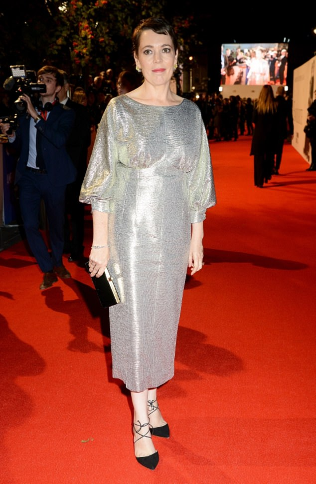 Shimmering star: The actress, 44, looked sensational in her silver gown which sparkled when she worked every angle under the heavy spotlight on the red carpet