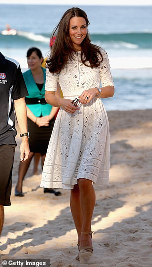 Meghan's shoeless look was a far cry from Kate's towering cork wedges which she wore on the second leg of her Australia tour in 2014 (pictured on Sydney's Manly beach on 18 April 2014)