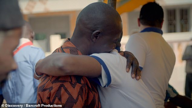 His only long-standing supporter: Kambou pictured with his father, who never abandoned him