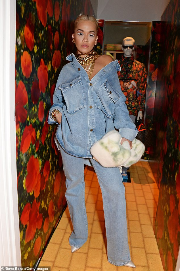 Standing tall: Rita added to her height in pointed ivory heels which complemented her denim ensemble