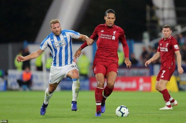 Huddersfield's Laurent Depoitre (left) and Liverpool's Virgil van Dijk scrap for possession as the two sides locked horns