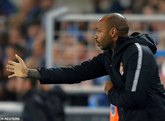 Henry gestures on the touchline in his first match in charge as a manager on Saturday night