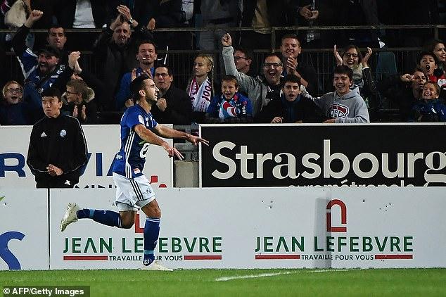 Strasbourg's French midfielder Adrien Thomasson celebrates scoring the first goal of match