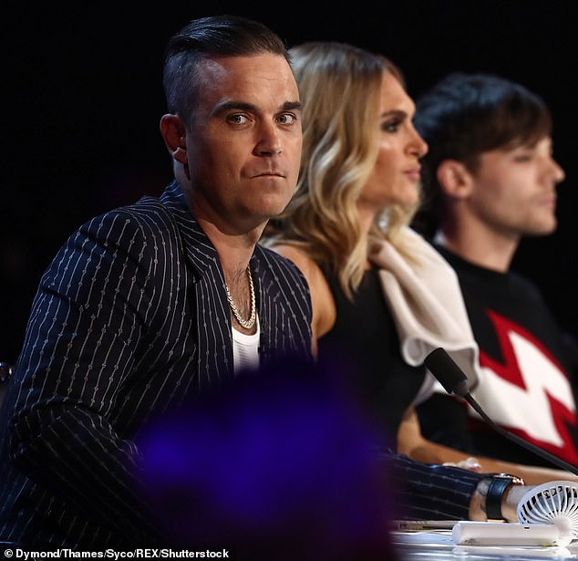 Angry: X Factor fans slammed bosses SILENCING Louis Tomlinson's microphone after Robbie Williams savagely attacked One Direction on Saturday
