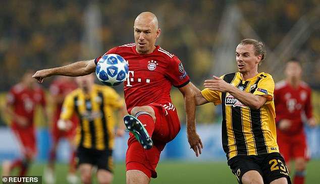 Arjen Robben shields the ball from AEK Athens' Nilas Hult during the early stages
