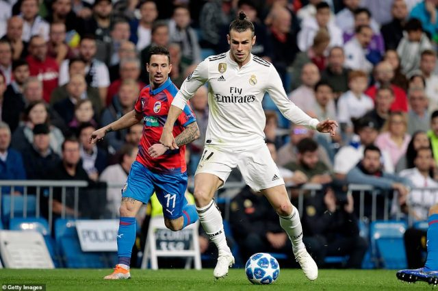 Real Madrid and Wales star Gareth Bale looks to play the ball forward as MilanPetrzela watches on from behind