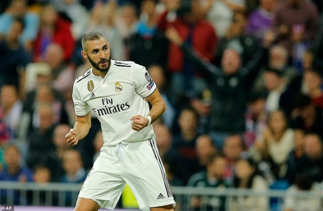 French striker Benzema celebrates in front of the home fans after breaking the deadlock early on in Tuesday night's game