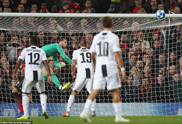 David de Gea makes a save from Blaise Matuidi's follow up to Ronaldo's free kick shortly before half time