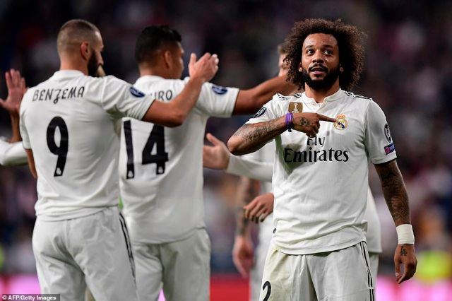 Marcelo makes a point of pointing at the Real Madrid crest on his chest after scoring in successive games