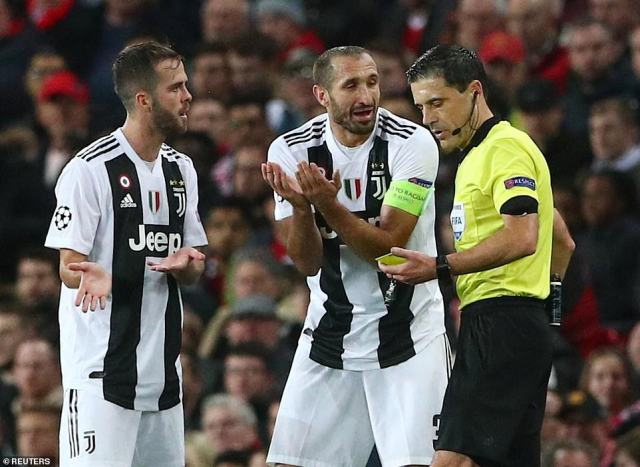 Juventus captain Giorgio Chiellini appeals to the referee after he is handed a yellow card late in the second half
