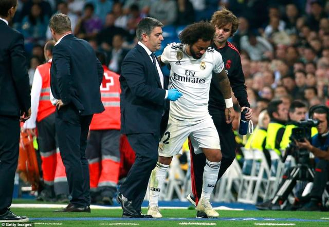 Real Madrid lynchpin Marcelo is helped from the pitch by the medical staff after picking up a late injury in the game