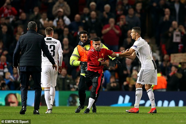 The fan, who was dressed head-to-toe in United gear, was chased down by a steward