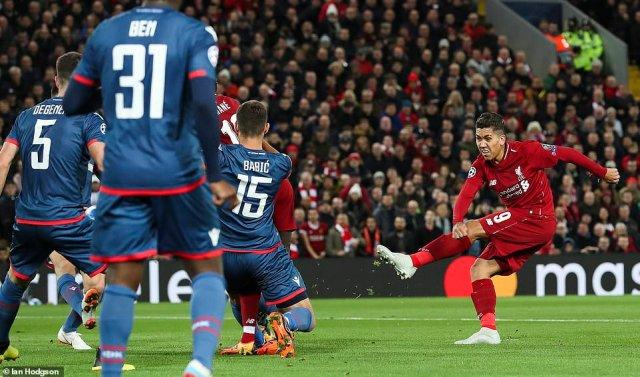 Firmino fires a left-footed shot towards goal, which beat Red Star Belgrade goalkeeperBorjan via a deflection