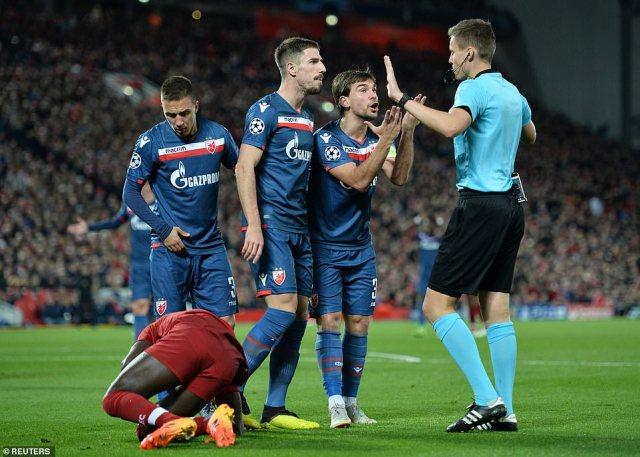 Red Star Belgrade's Stojkovic and Milos Degenek remonstrate with referee Daniel Siebert after hosts were awarded spot-kick