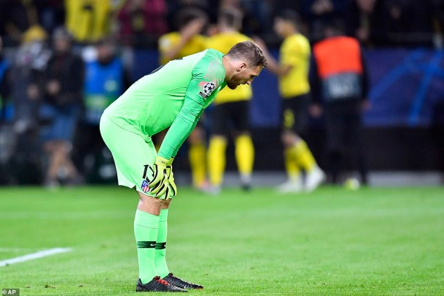 Oblak crouched forward with his hands on his knees as Dortmund's players celebrated in the background in Germany