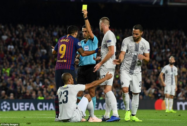 Suarez picked up a yellow card from referee Ovidiu Hategan and protested his innocence after his challenge