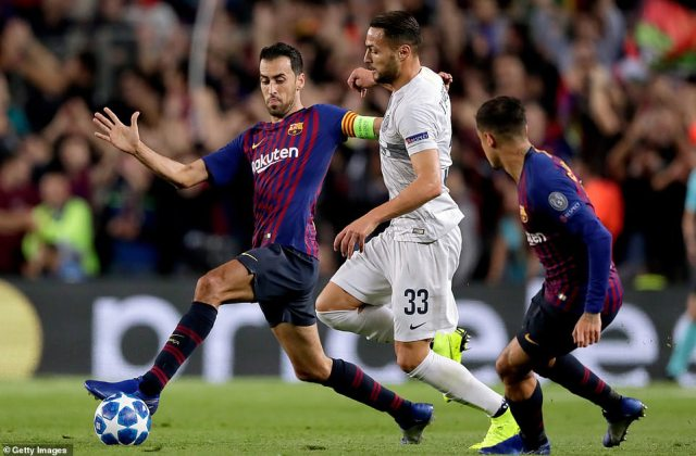 Sergio Busquets stretches to reach the ball under pressure from Danilo d'Ambrosio during the second half